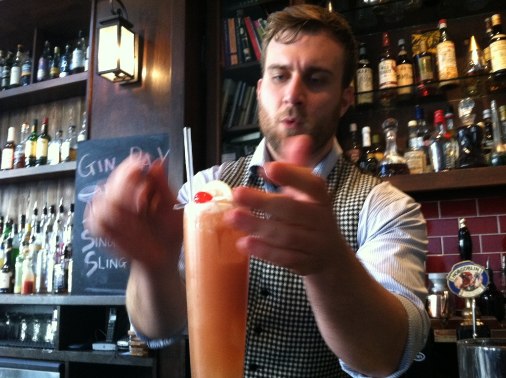 Simon working his magic and creating a Singapore Sling.